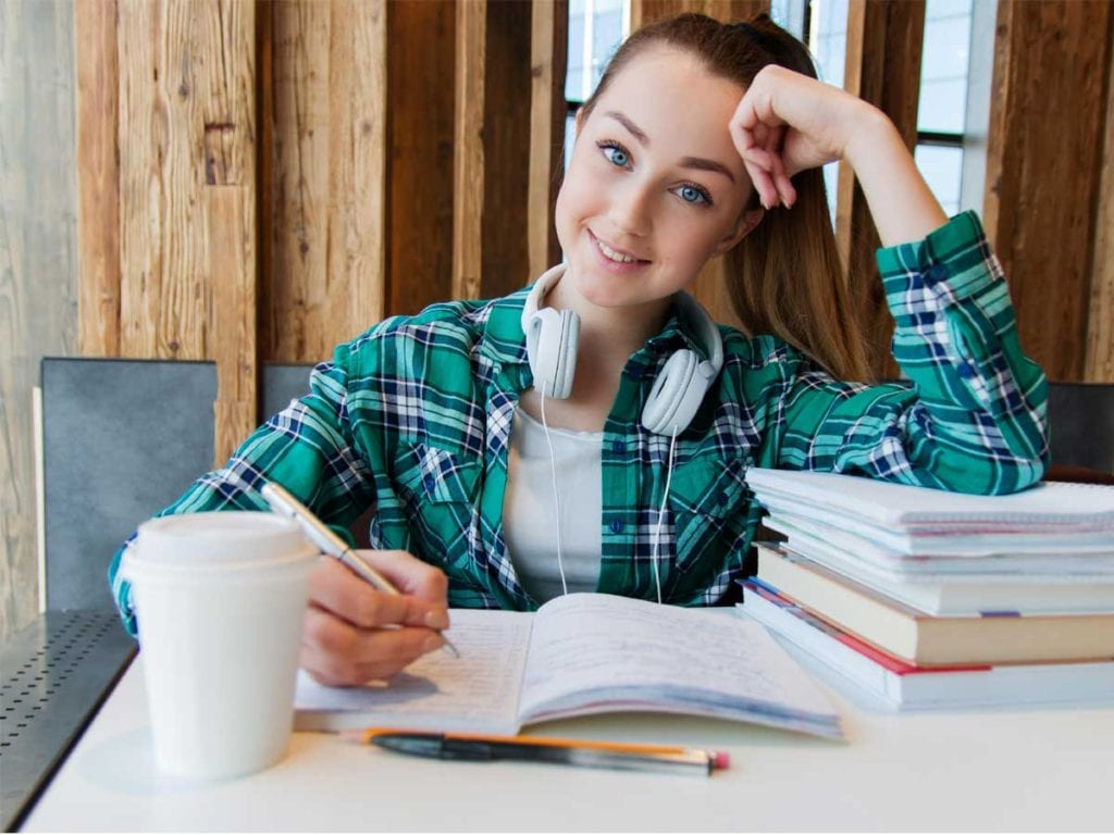 Student studying with music